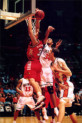 December 18, 2001: Fighting Illini basketball paler Brian Cook and Illinois State University Redbirds basketball player Chad Mazanowski...This image was scanned from a print.  Image quality may vary.  Dust and other unwanted artifacts may exist.