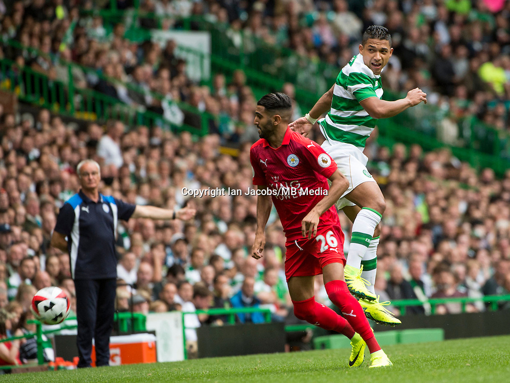 Football, International Champions Cup, Parkhead Stadium, Glasgow. Celtic v Leicester City. Leicester win 6-5 on penalties<br /> Pic shows: Leicester's Riyad Mahrez and Celtic's Emilio Izaguirre fight for the ball as Leicester Coach Claudio Ranieri looks on.