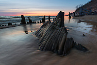 The remains of an old stump endures the incoming waves of Lake Michigan