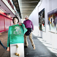 Nederland, Amsterdam , 15 mei 2013.<br /> De KunstRAI begint woensdagavond in de RAI in Amsterdam. Op de 29e editie van de nationale kunstbeurs kunnen bezoekers kunst en design van ruim 75 bekende en opkomende galerieën aanschouwen en kopen.<br /> De KunstRAI wil bezoekers stimuleren echt aandacht te hebben voor kunst met een zogenoemde kunstdate. Geïnteresseerden kunnen aan een gedekt tafeltje een gerecht verorberen dat is geïnspireerd op een kunstwerk. Het is de bedoeling dat ze een kunstwerk beter leren kennen tijdens de eetafspraak.<br /> Naast een algemene stand hebben ongeveer 20 galerieën ook een speciale kraam waarin zij het werk van één kunstenaar exposeren.<br /> Op de foto: een bezoeker van de KunstRAI loopt langs kunst van kunstenaar Hidde van Schie van Galerie Jaap Sleper.<br /> The art fair KunstRAI in the RAI in Amsterdam. On the 29th edition of the national art fair visitors can watch, admire and buy art and design of more than 75 known and emerging galleries .