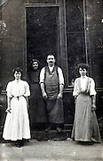shop owner with workers posing in door opening France 1910s