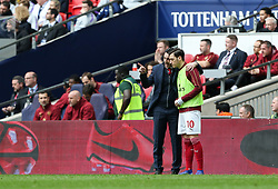 Arsenal Manager Unai Emery has words with Mesut Ozil of Arsenal before bringing him on - Mandatory by-line: Arron Gent/JMP - 02/03/2019 - FOOTBALL - Wembley Stadium - London, England - Tottenham Hotspur v Arsenal - Premier League