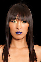 Portrait of Asian woman wearing blue lipstick