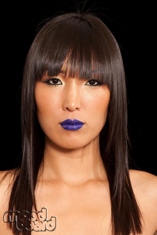 Portrait of Asian woman wearing blue lipstick