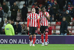 Josh Maja of Sunderland appears to laugh as team-mate Bryan Oviedo looks dejected after being sent off - Mandatory by-line: Joe Dent/JMP - 02/10/2018 - FOOTBALL - Stadium of Light - Sunderland, England - Sunderland v Peterborough United - Sky Bet League One