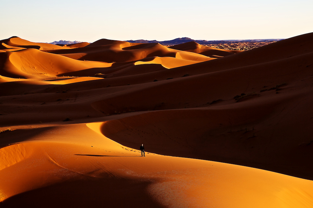Even standing on the edge of the Erg Chebbi Sand Dunes can feel a very desolate lonely place as the sun spreads its long fingers across the land...