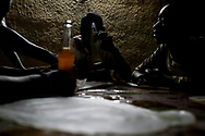 The Kigali Survivor Boys enjoy a warm meal at a restaurant in the Grisozi Ghetto in Kigali, Rwanda on July 16, 2011. The boys, who range in age from 17 to 29, earned money earlier in the day for dinner by selling maps, flash drives and pirated DVD films. Orphaned during one of mankindís darkest chapters, the 1994 Rwandan Genocide, the Kigali Survivor Boys are a tightly knit group of young men whose daily survival depends upon their ability to peddle maps, belts and pirated films to passers-by in and around the city center.