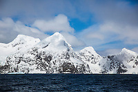 Mountains with snow and ice with dark blue ocean, Antarctica. Landscape and Nature photography wall art. Fine art photography prints, stock images.