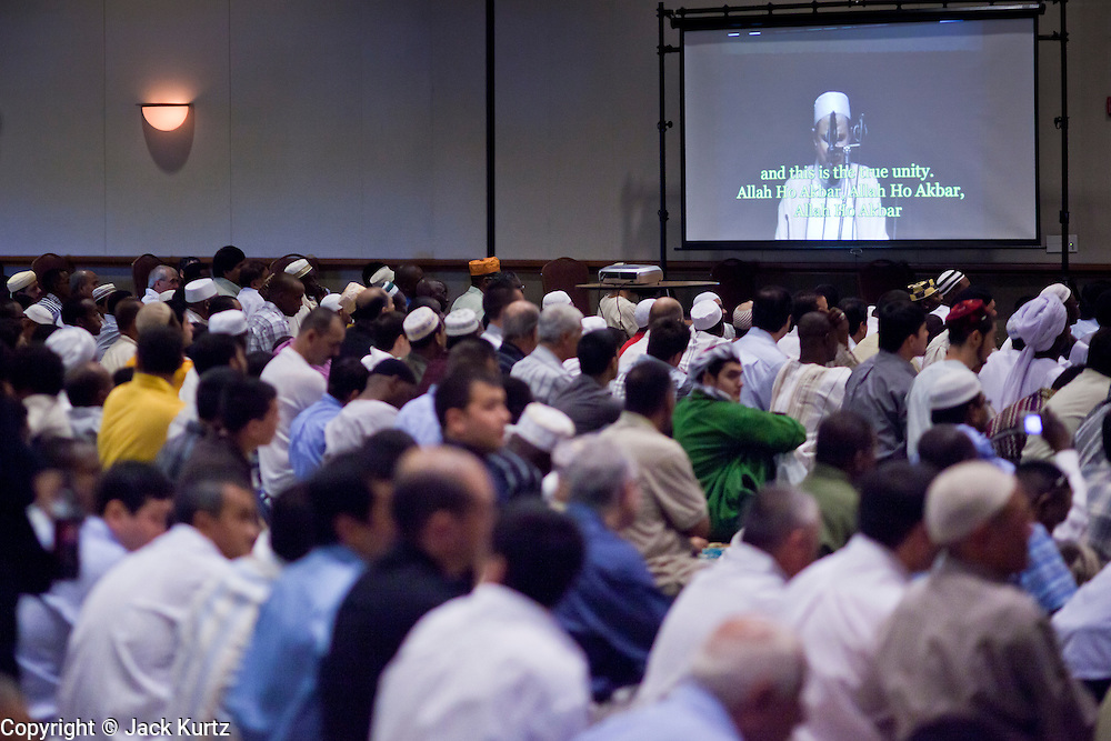 "Sept. 10 - GLENDALE, AZ: Muslim men listen to the Imam's sermon during Eid ul-Fitr services in the Glendale Civic Center. More than 3,000 Muslims from the Phoenix area celebrated Eid ul-Fitr, the end of Ramadan, at the Glendale Civic Center in Glendale, AZ, a suburb of Phoenix. Eid ul-Fitr, often abbreviated to Eid, is the Muslim holiday that marks the end of Ramadan, the Islamic holy month of fasting. Eid is an Arabic word meaning ""festivity"", while Fitr means ""conclusion of the fast""; and so the holiday symbolizes the celebration of the conclusion of the month of fasting from dawn to sunset during the entire month of Ramadan. The first day of Eid, therefore, is the first day of the month Shawwal that comes after Ramadan.  Photo by Jack Kurtz"