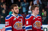 KELOWNA, CANADA - FEBRUARY 22: Tyler Robertson #21 of the Edmonton Oil Kings stands on the ice during the national anthem against the Kelowna Rockets on February 22, 2017 at Prospera Place in Kelowna, British Columbia, Canada.  (Photo by Marissa Baecker/Shoot the Breeze)  *** Local Caption ***