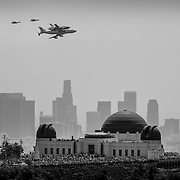 "After several missions, the Space Shuttle Endeavour was retired to the California Space Center. Transporting the shuttle required flying it piggybacked on a Boeing plane, then towing it through city streets to the museum. These days were truly historic for Los Angeles. Before landing the Shuttle at the LA Airport, it was taken on a ""victory lap"" circling the greater Los Angeles area and flying over major landmarks.  Griffith Park and the Griffith Observatory lawn saw one of the biggest crowds it had ever seen. I climbed further up the hill to get this view, capturing the flyover, and the historic crowd of people there to see it."