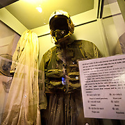 The flight suit that John McCain was wearing when he was shot down over Hanoi and taken to Hoa Lo Prison. Hoa Lo Prison, also known sarcastically as the Hanoi Hilton during the Vietnam War, was originally a French colonial prison for political prisoners and then a North Vietnamese prison for prisoners of war. It is especially famous for being the jail used for American pilots shot down during the Vietnam War.