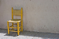 Yellow Chair against Brick Wall in Istanbul