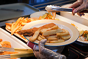 Fish and chips served up in the restaurant at Hackney Community College, London.
