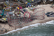 Shoreline erosion takes out boardwalk and leaves Funtown Amusement park at water edge.