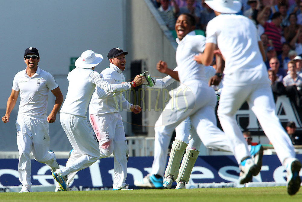 Ian Bell of England celebrates the wicket of Ravichandran Ashwin of India during day three of the fifth Investec Test Match between England and India held at The Kia Oval cricket ground in London, England on the 17th August 2014<br /> <br /> Photo by Ron Gaunt / SPORTZPICS/ BCCI
