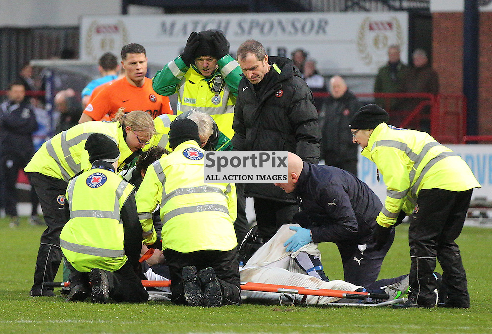 Dundee v Dundee United Scottish Premiership 2 January 2016; a concerned expression from a first aider after James McPake (Dundee, 5) suffers a serious knee injury in a challenge with John Rankin (Dundee United, 8) during the Dundee v Dundee United Scottish Premiership match played at Dens Park Stadium;