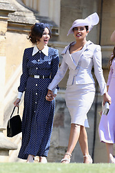 Suits actress Abigail Spencer and Bollywood actress Priyanka Chopra (right) arrive at St George's Chapel in Windsor Castle for the wedding of Prince Harry and Meghan Markle.