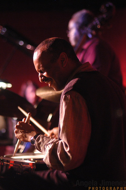 Drummer Billy Drummond, foreground, and bassist Ray Drummond perform with The Drummonds at the Jazz Standard in Manhattan on April 8, 2003.