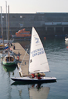 Dun Laoghaire Harbour, Dublin, Ireland. Sail boat crew arriving to the pier.