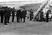 President John F. Kennedy arrives at Dublin Airport. He is greeted by President Eamon de Valera as he steps fom the plane.  An Taoiseach Seán Lemass waits to greet him.<br />