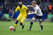 Souleymane Doukara of Leeds United under pressure from Bolton Wanderers defender Robert Holding during the The FA Cup fourth round match between Bolton Wanderers and Leeds United at the Macron Stadium, Bolton, England on 30 January 2016. Photo by Simon Brady.