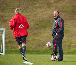 LIVERPOOL, ENGLAND - Wednesday, March 17, 2010: Liverpool's manager Rafael Benitez watches as Fernando Torres trains at Melwood Training Ground ahead of the UEFA Europa League Round of 16 2nd Leg match against LOSC Lille Metropole. (Photo by David Rawcliffe/Propaganda)