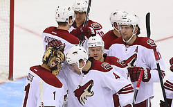 Mar 27, 2014; Newark, NJ, USA; The Phoenix Coyotes congratulate Phoenix Coyotes goalie Thomas Greiss (1) on his 3-2 shootout win over the New Jersey Devils at Prudential Center.