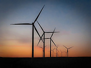 Twilight light in the sky with silhouetted electric generating windmills in the Palouse region of eastern Washington, USA