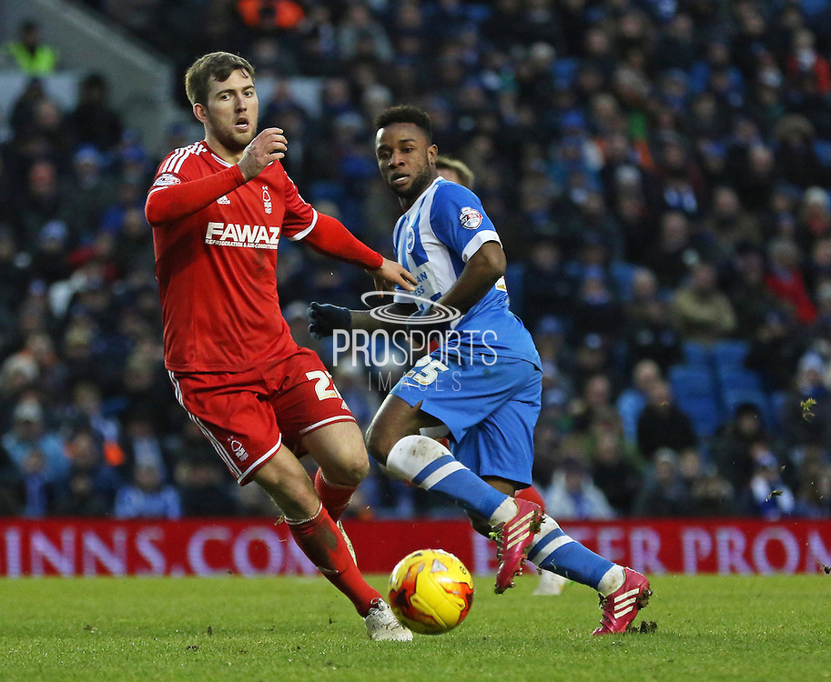 Nottingham Forest's Gary Gardner battling with Brighton's Kazenga LuaLua during the Sky Bet Championship match between Brighton and Hove Albion and Nottingham Forest at the American Express Community Stadium, Brighton and Hove, England on 7 February 2015. Photo by Phil Duncan.