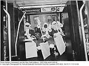 Three Father Christmas's on a New York bus. 1992.film no921081f6<br />