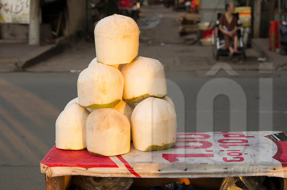 Coconuts for sales in a street of Ho Chi Minh city, Vietnam, Asia