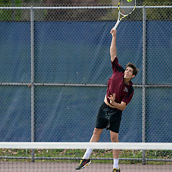 Staff photos by Tom Kelly IV<br /> Radnor's Josh Taylor serves during the second singles match to Unionville's Zack Sokoloff during the District One tennis match between Radnor and Unionville at Unionville High School in East Marlborough Township, Tuesday afternoon.