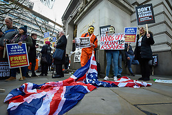 © Licensed to London News Pictures. 22/02/2020. LONDON, UK.  People in maskes outside Australia House in Aldwych ahead of a march to Parliament Square in support of Wikileaks founder Julian Assange.  The full extradition trial of Mr Assange begins in London on 24 February.  Photo credit: Stephen Chung/LNP