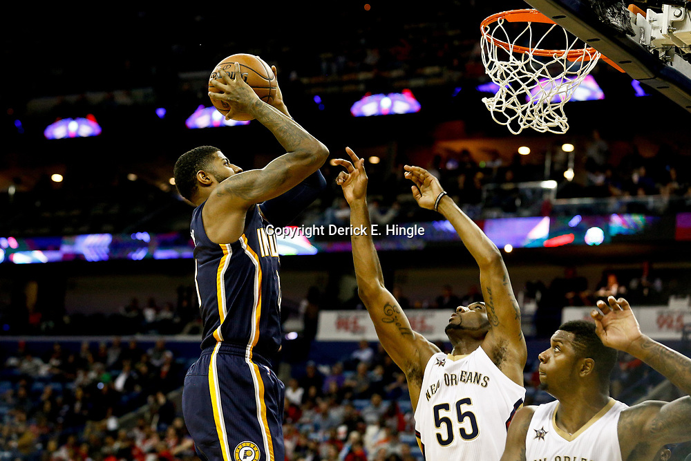 Dec 15, 2016; New Orleans, LA, USA; Indiana Pacers forward Paul George (13) shoots over New Orleans Pelicans guard E'Twaun Moore (55) and forward Terrence Jones (9)  during the second quarter of a game at the Smoothie King Center. Mandatory Credit: Derick E. Hingle-USA TODAY Sports