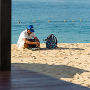 Arts and craft salesman setting up at the beach for a hard day's work. El Medano beach. Cabo San Lucas, BCS.