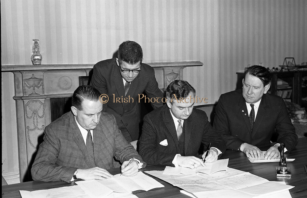 New Industrial Development At Bunbeg, Donegal..1968..30.01.1968..01.30.1968..30th January 1968..At a press conference at Gaeltarra Éireann,Dublin today, an announcement was made of a major new industrial development at Bunbeg, Co Donegal. An agreement was signed for the establishment of a company, Ambler of Donegal Ltd,for the production of fancy and loop yarns for the weaving industry. the company is a subsidiary of Jeremiah Ambler Limited of Bradford, Yorkshire...Image shows (L-R), Mr Padraig Ó Fachtna, Parliamentary Secretary to the Minister for the Gaeltacht; Mr Ivor Kenny, Chairman, Gaeltarra Éireann  and Mr F J Croft, Director, Jeremiah Ambler Ltd. Standing is Mr Cathal Mac Gabhann,General Manager, Gaeltarra Éireann at the signing of the agreement.