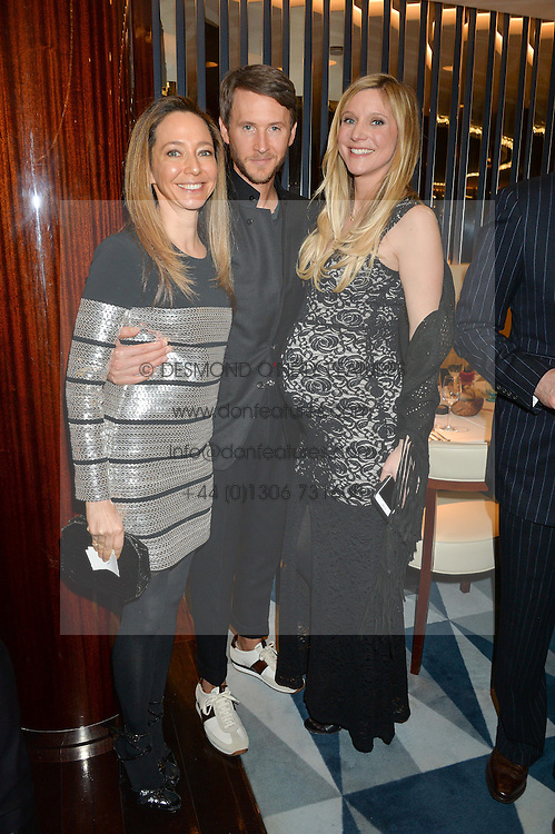 Left to right, WHITNEY BROMBERG HAWKINGS, PETER HAWKINGS and CALGARY AVANSINO at a dinner hosted by AA Gill & Nicola Formby in support of the Borne charity held at Rivea at the Bulgari Hotel, Knightsbridge, London on 3rd February 2015.