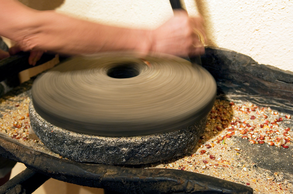 Rotary stone quern grinding corn in the Molino De Gofio ethnographic museum in the Hermigua valley, La Gomera, Canary Islands