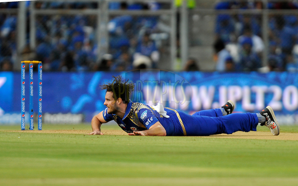 Mitchell McClenaghan of Mumbai Indians looses his balance as he bowls during match 23 of the Pepsi IPL 2015 (Indian Premier League) between The Mumbai Indians and The Sunrisers Hyferabad held at the Wankhede Stadium in Mumbai India on the 25th April 2015.<br /> <br /> Photo by:  Pal Pillai / SPORTZPICS / IPL