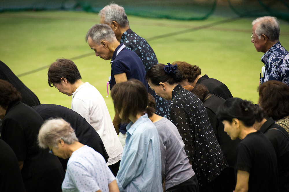 OKINAWA, JAPAN - JUNE 17 : People of Okinawa bow to pray and give respect for the victim of an alleged rape and murder, Rina Shimabukuro, in Okunai-Undojo Gym, Nago, Okinawa prefecture on June 17, 2016. Kenneth Franklin Shinzato, a 32-year-old former U.S. Marine employed by Kadena Air Base, was arrested on dumping the woman's body in Onna, Okinawa Prefecture. Photo Richard A. de Guzman