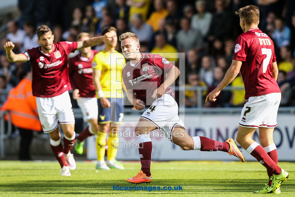 Sam Hoskins of Northampton Town (centre)  celebrates after scoring scores their first goal during the Sky Bet League 2 match at Sixfields Stadium, Northampton<br /> Picture by Andy Kearns/Focus Images Ltd 0781 864 4264<br /> 12/09/2015
