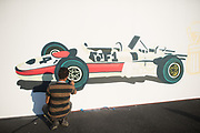 October 27-29, 2017: Mexican Grand Prix. An artist paints a race car in the paddock