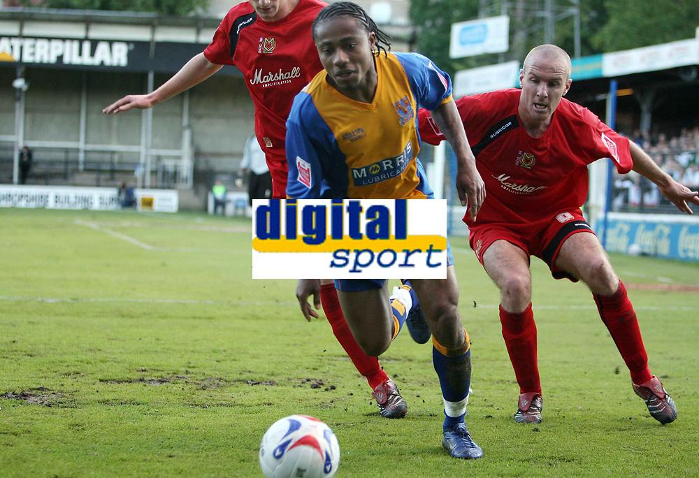 Photo: Rich Eaton.<br /> <br /> Shrewsbury Town v Milton Keynes Dons. Coca Cola League 2. Play off Semi Final, 1st Leg. 14/05/2007. ShrewsburysDerek Asamoah #10 is first to the ball