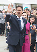 © Licensed to London News Pictures. 23/09/2014. Manchester, UK Leader of the Labour Party Ed Miliband arrives with his wife Justine ahead of giving his leaders speech at the Labour Party Conference 2014 at the Manchester Convention Centre today 23 September 2014. Photo credit : Stephen Simpson/LNP
