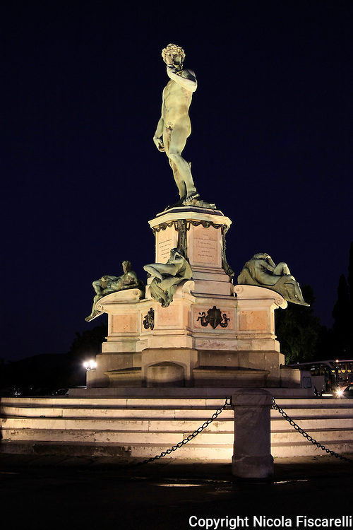 "A night view of a  copy statue  of "" David"" in  Piazzale Michelangelo Florence."