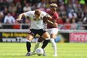Sheffield United forward Billy Sharp (10) battles for possession  with Northampton Town trialist  Romeao Hutton (7) during the Pre-Season Friendly match between Northampton Town and Sheffield United at the PTS Academy Stadium, Northampton, England on 20 July 2019.