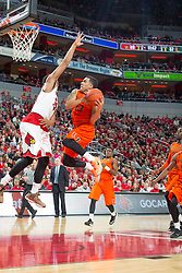 Miami guard Angel Rodriguez, right, shoots over Louisville guard/forward Wayne Blackshear in the second half. <br /> <br /> The University of Louisville hosted the University of Miami, Saturday, Feb. 21, 2015 at The Yum Center in Louisville. Louisville won 55-53.<br /> <br /> Photo by Jonathan Palmer