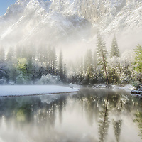 Misty morning above the Merced River after a spring snow, Yosemite National Park, California.