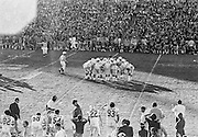 COLLEGE FOOTBALL:  The Stanford offense huddles early in the 1972 Rose Bowl game against Michigan played on January 1, 1972 at the Rose Bowl in Pasadena, California. Stanford won by a score of 13-12.  BW R0148-11